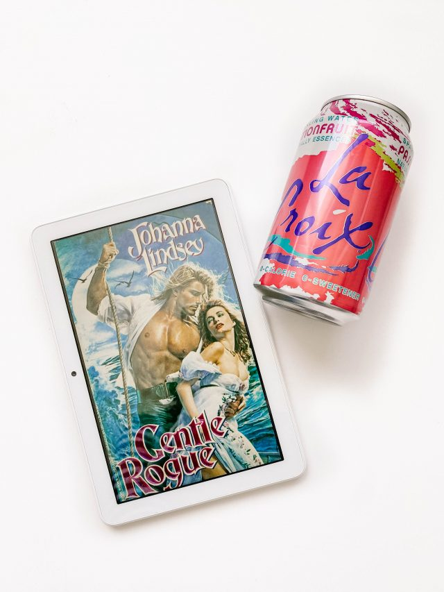 Can of Passionfruit La Croix next to the book cover of a romance novel entitled Gentle Rogue.